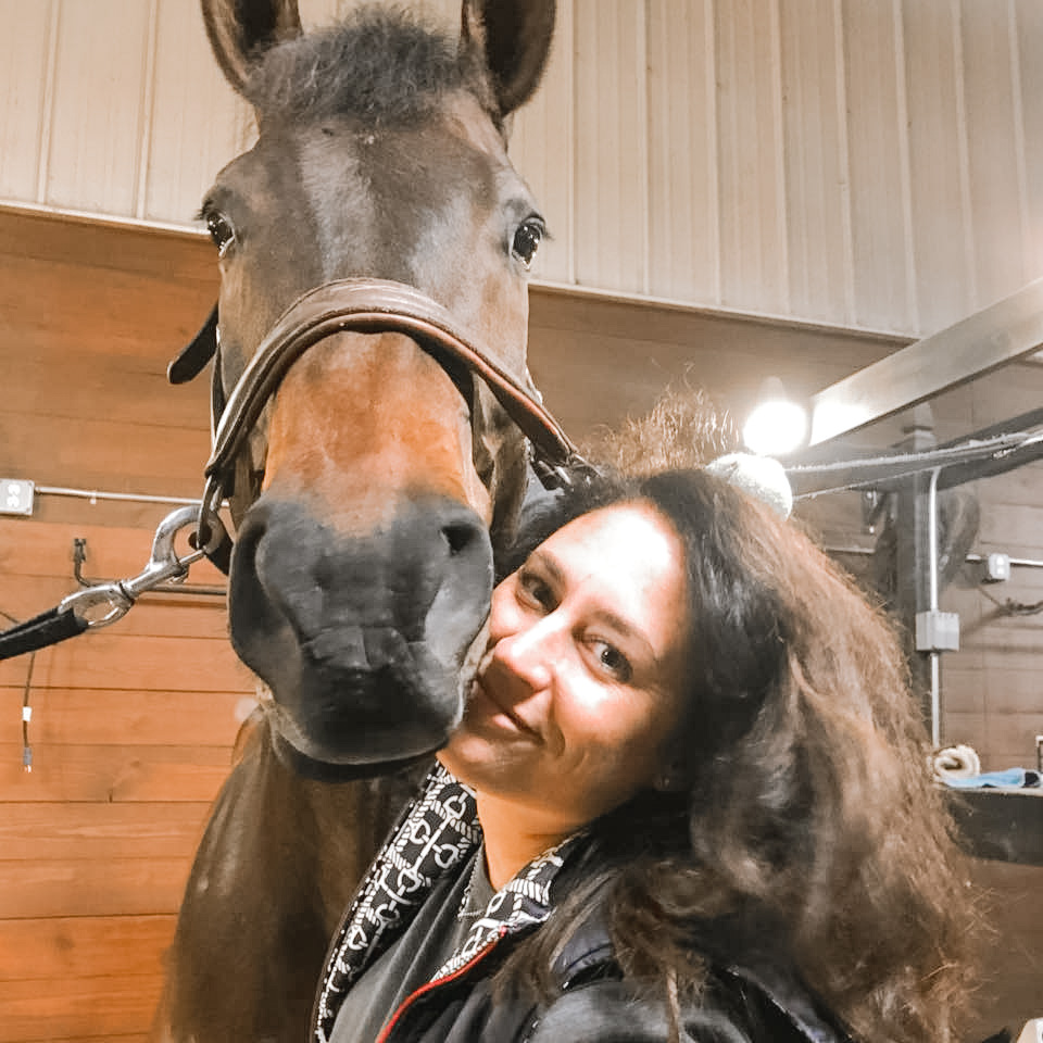 Anne Dolin with her daughter's horse.