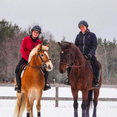 Naila and Catherine with their horses